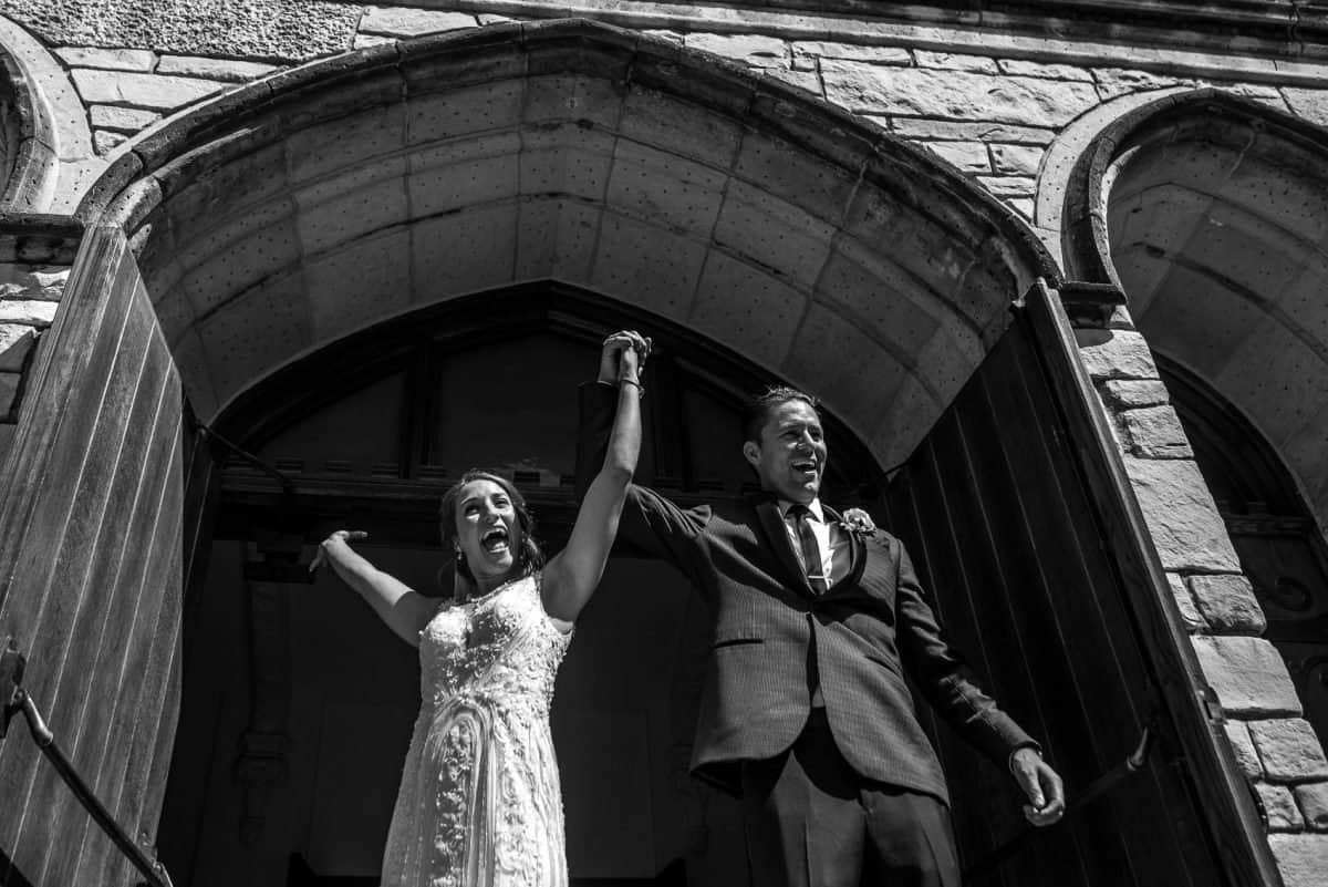 Documentary Wedding Photographers Couple Cheering