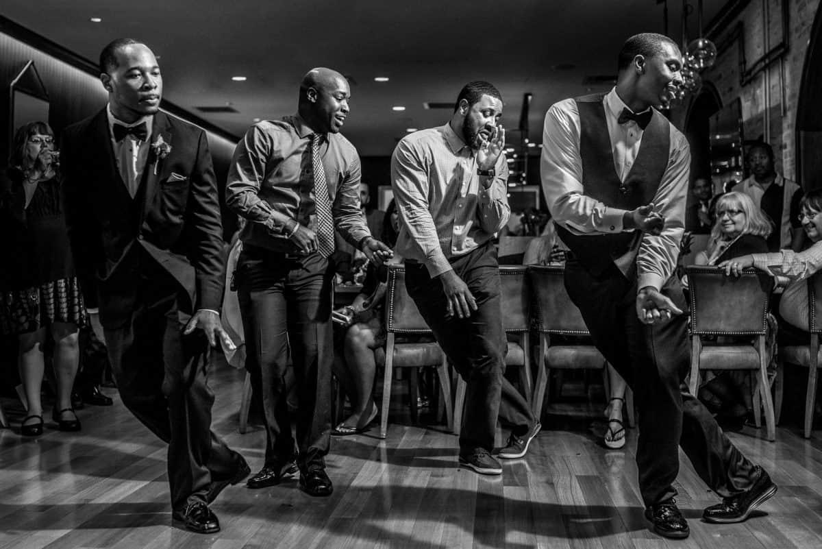 Documentary Wedding Photographers Groom Dancing
