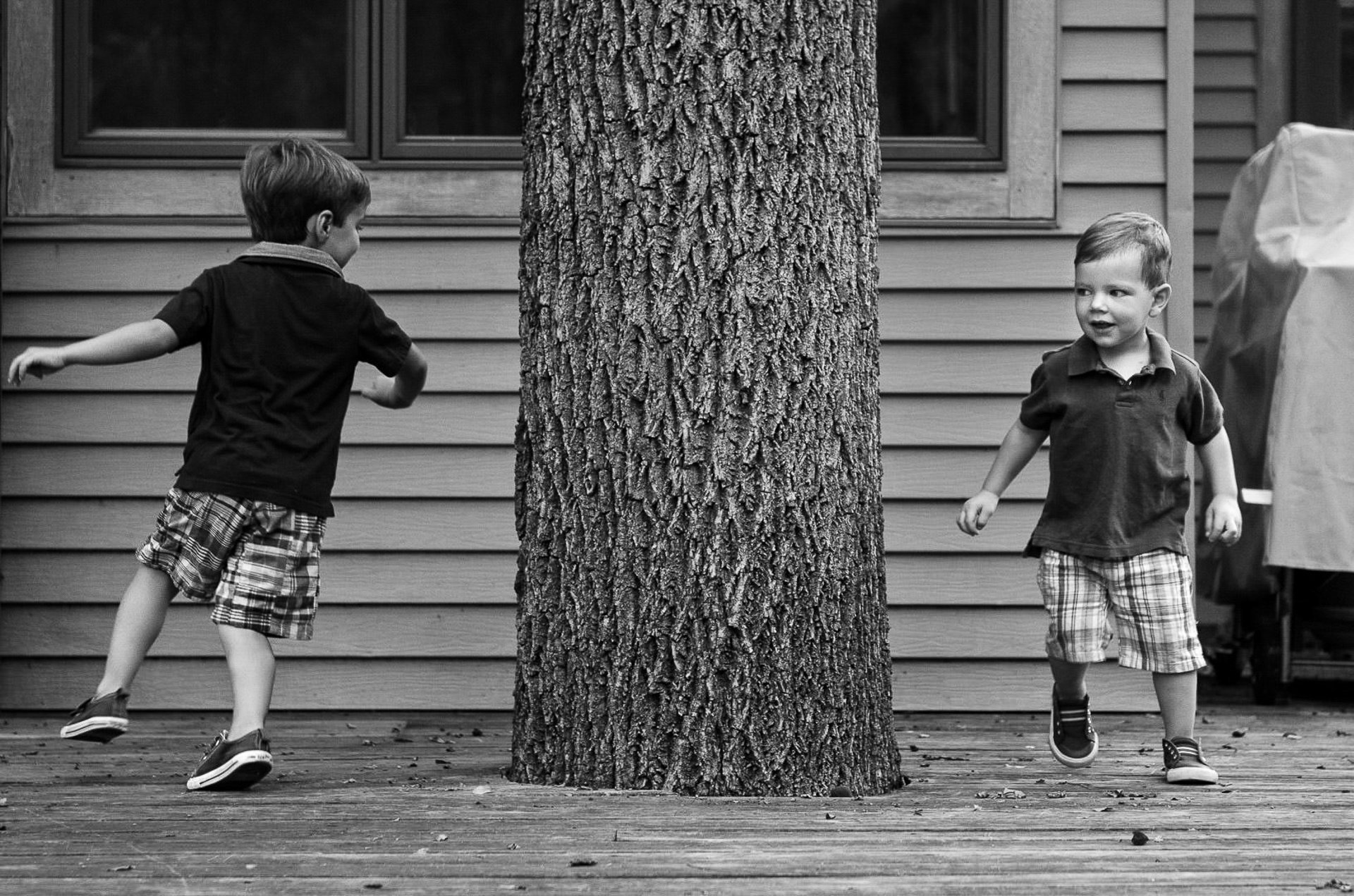 Siblings running after each other