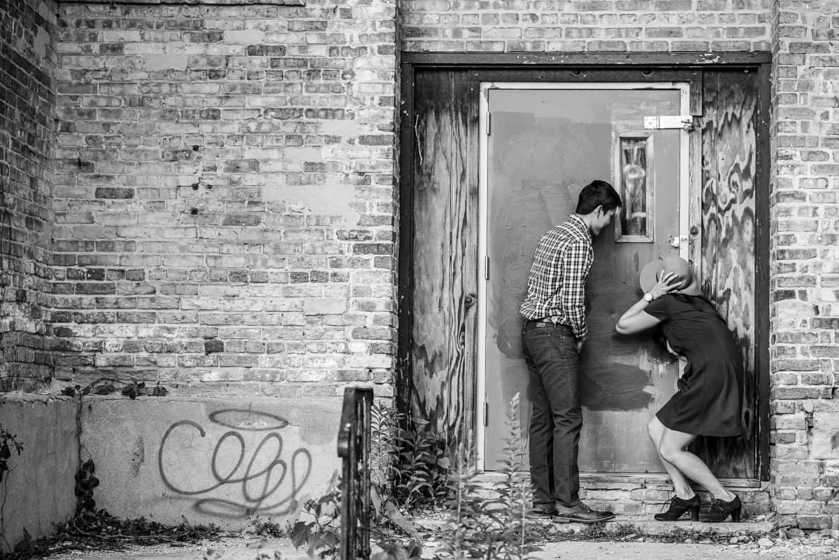 Engagement Photography Peeking In Keyhole
