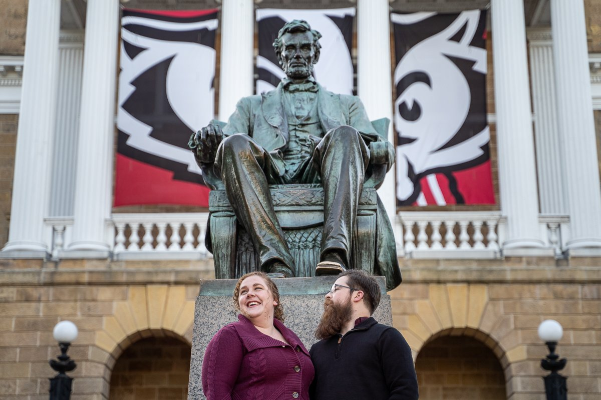 Couple smiling with Abraham Lincoln Statue behind