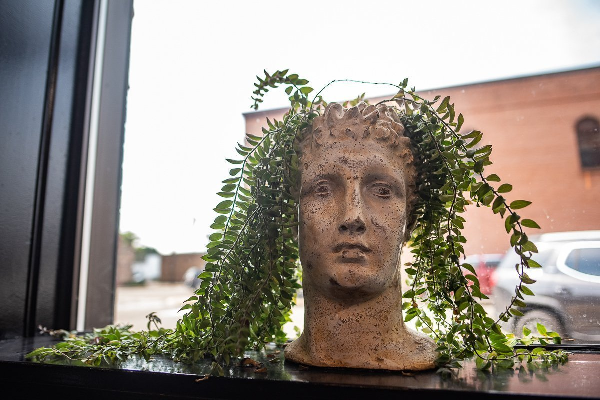 Statue with plant hair at the Blue angel Salon in Waupaca, WI