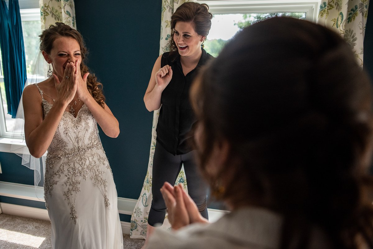 Bride almost crying before ceremony with bridesmaids