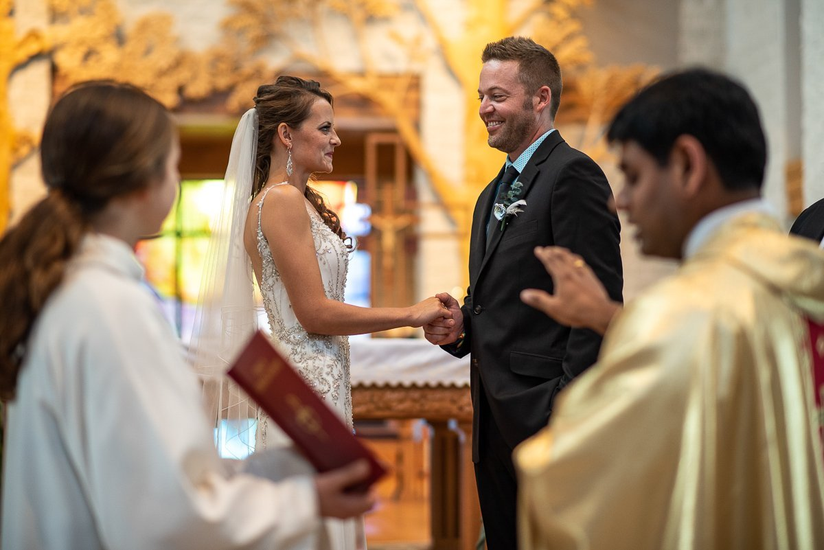 Priest blessing the couple