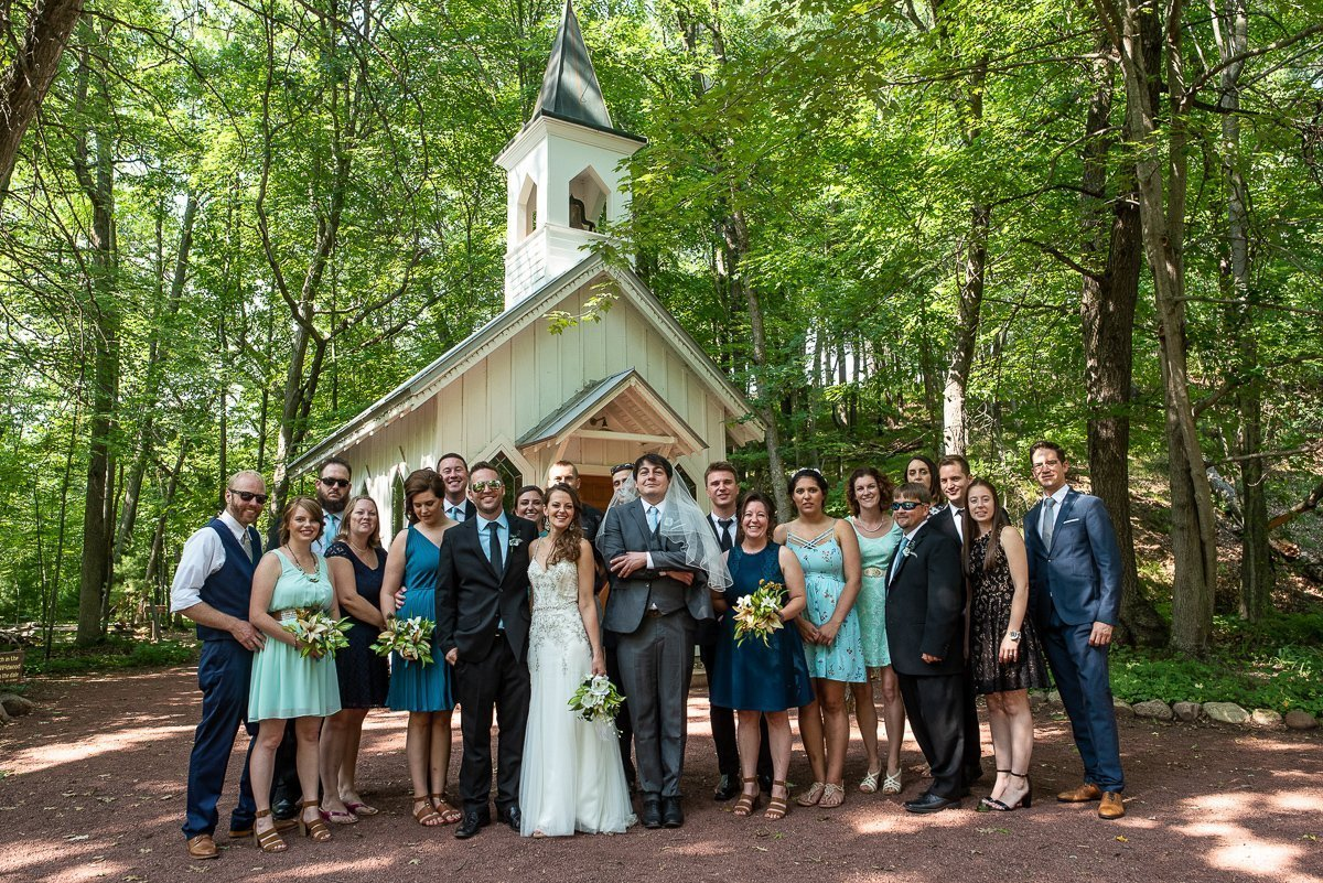 Wedding party in front a chapel in Wisconsin