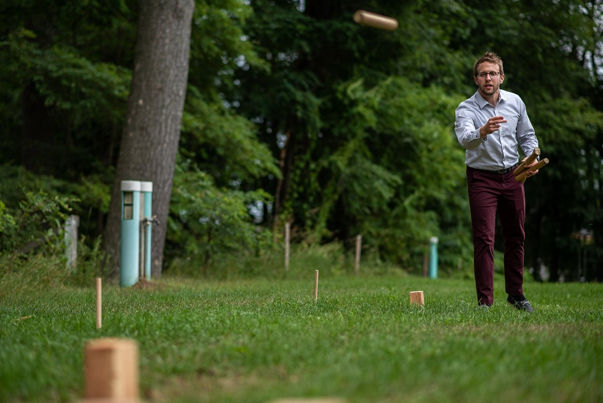 Guest playing a lawn game