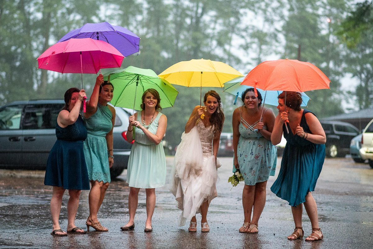 Bride and bridesmaids posing with colorful umbrellas