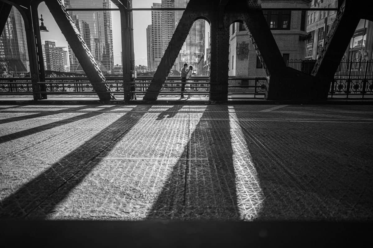 Wedding Photographer Madison WI Kiss on Bridge