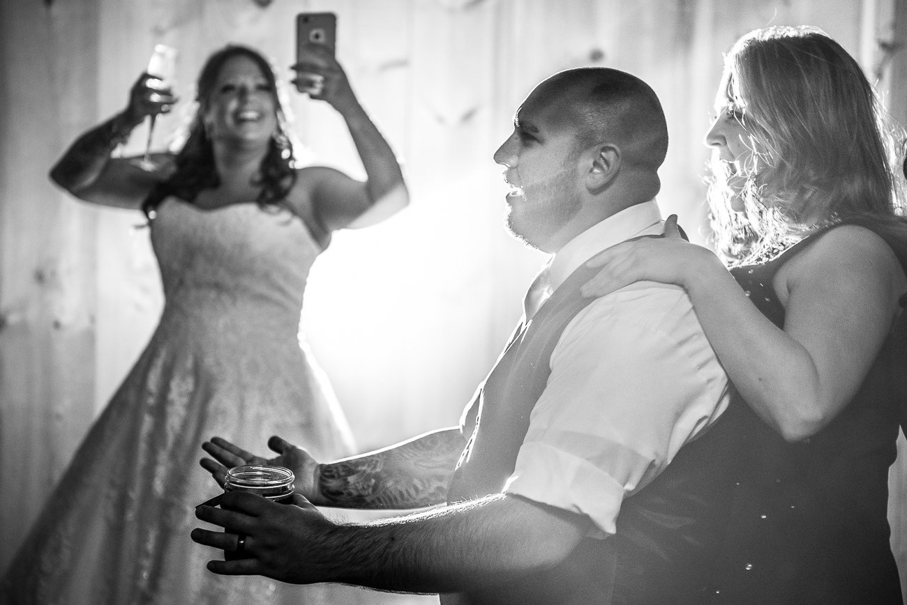 Wedding Photographers Madison WI Couple Partying