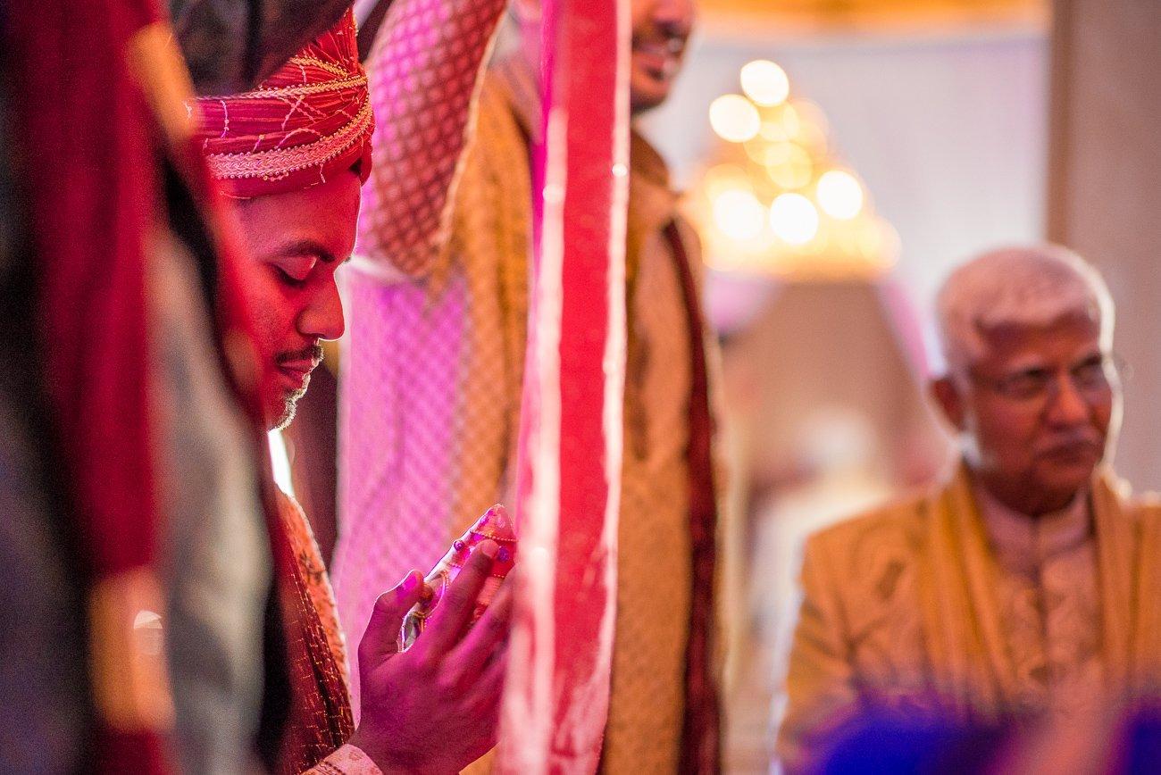 Wedding Photographers Madison WI Groom Behind Veil