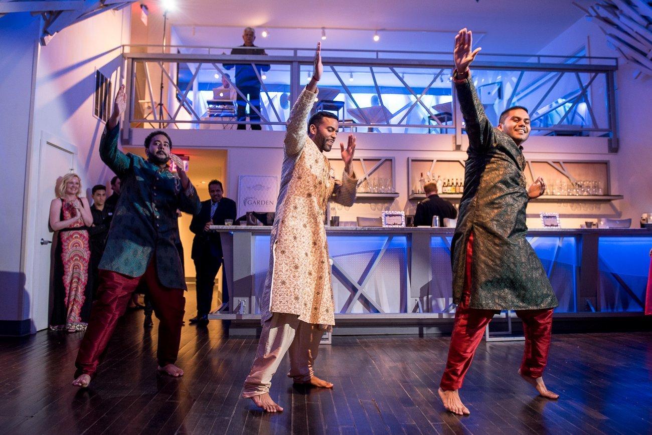 Wedding Photographers Madison WI Groom Dancing
