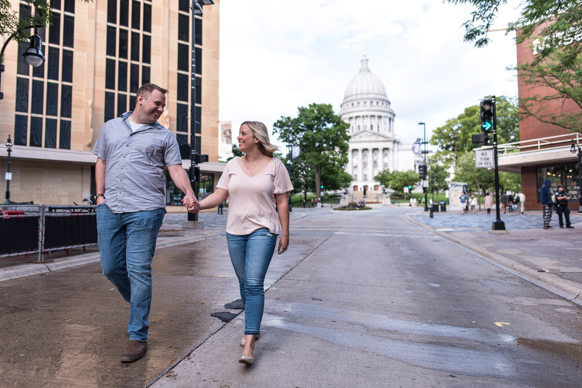 Engagement Photographers Madison WI Holding Hands Capitol