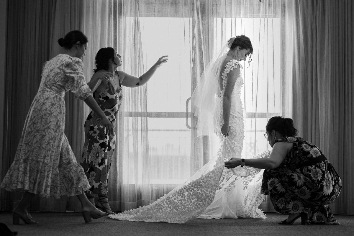 Bridesmaid helping bride gettind ready