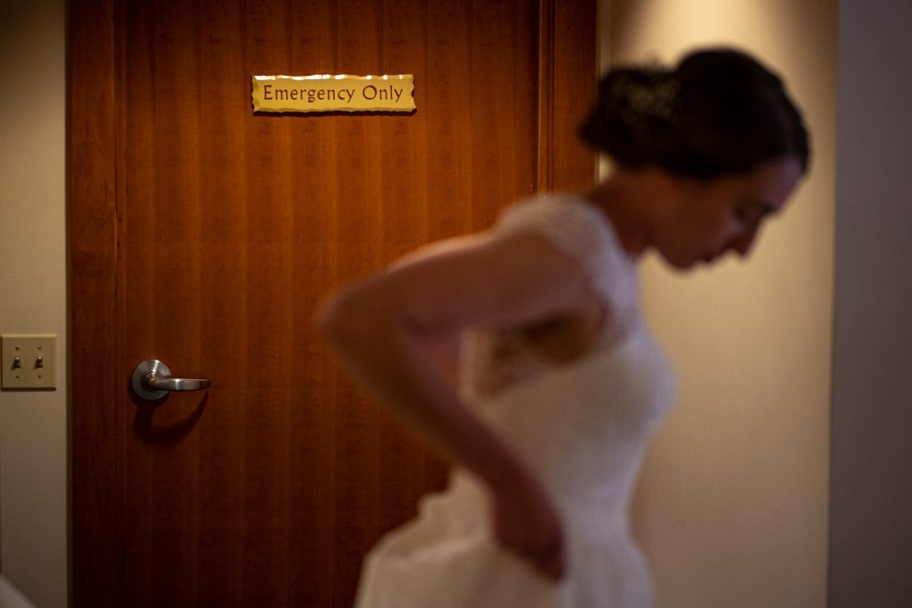 bride with emergency only sign at background