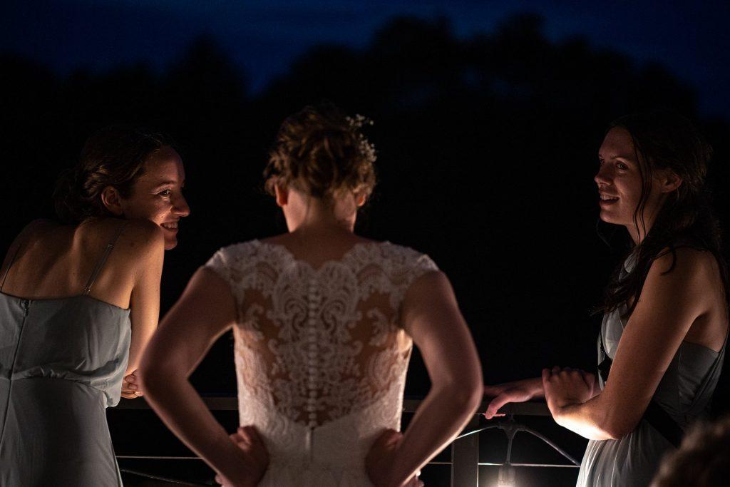 bride and bridesmaids talking during wedding reception
