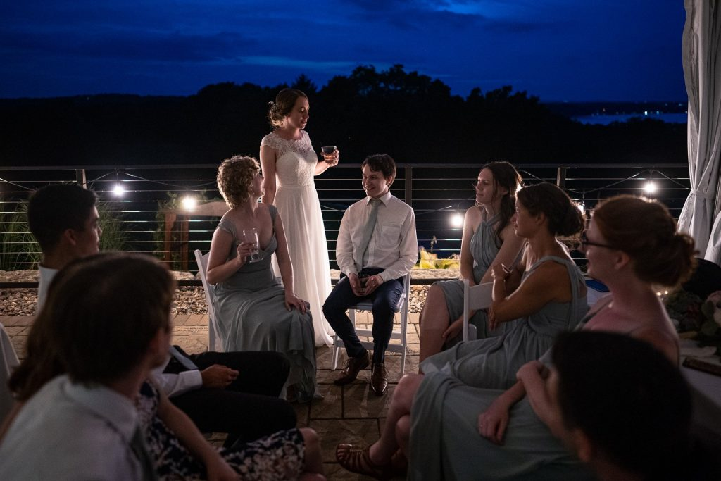 bride and groom in a circle with guests during wedding reception