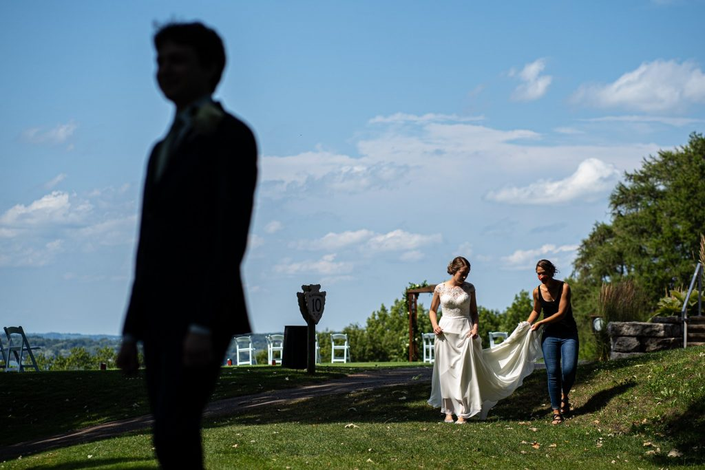 grooms silhouette with bride and bridesmaid on background