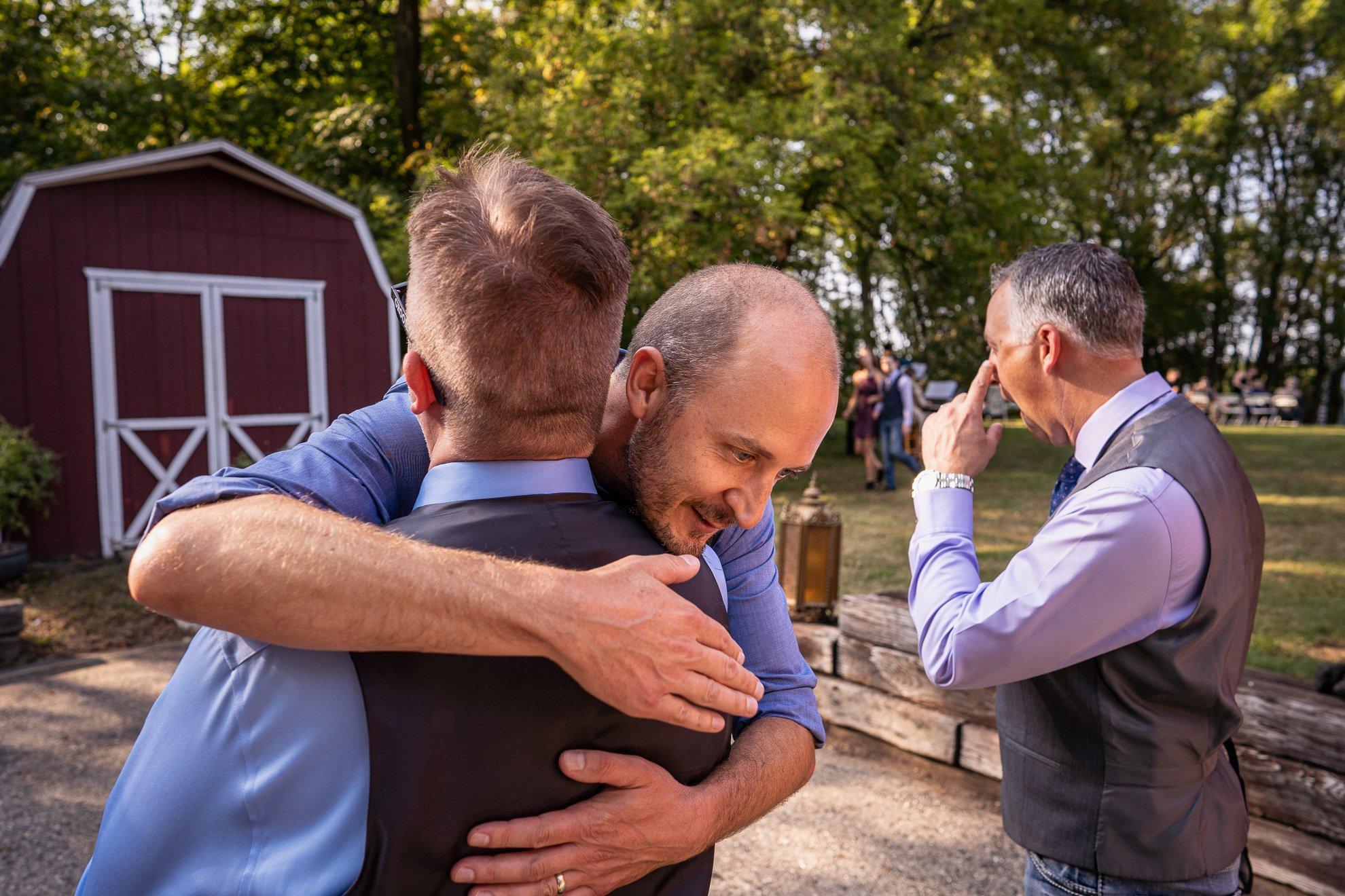 groomsman hugging groom at vignette dining club