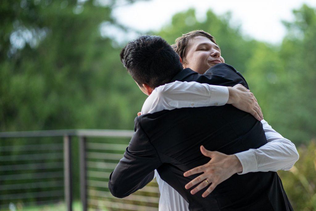 groom hugging the best man