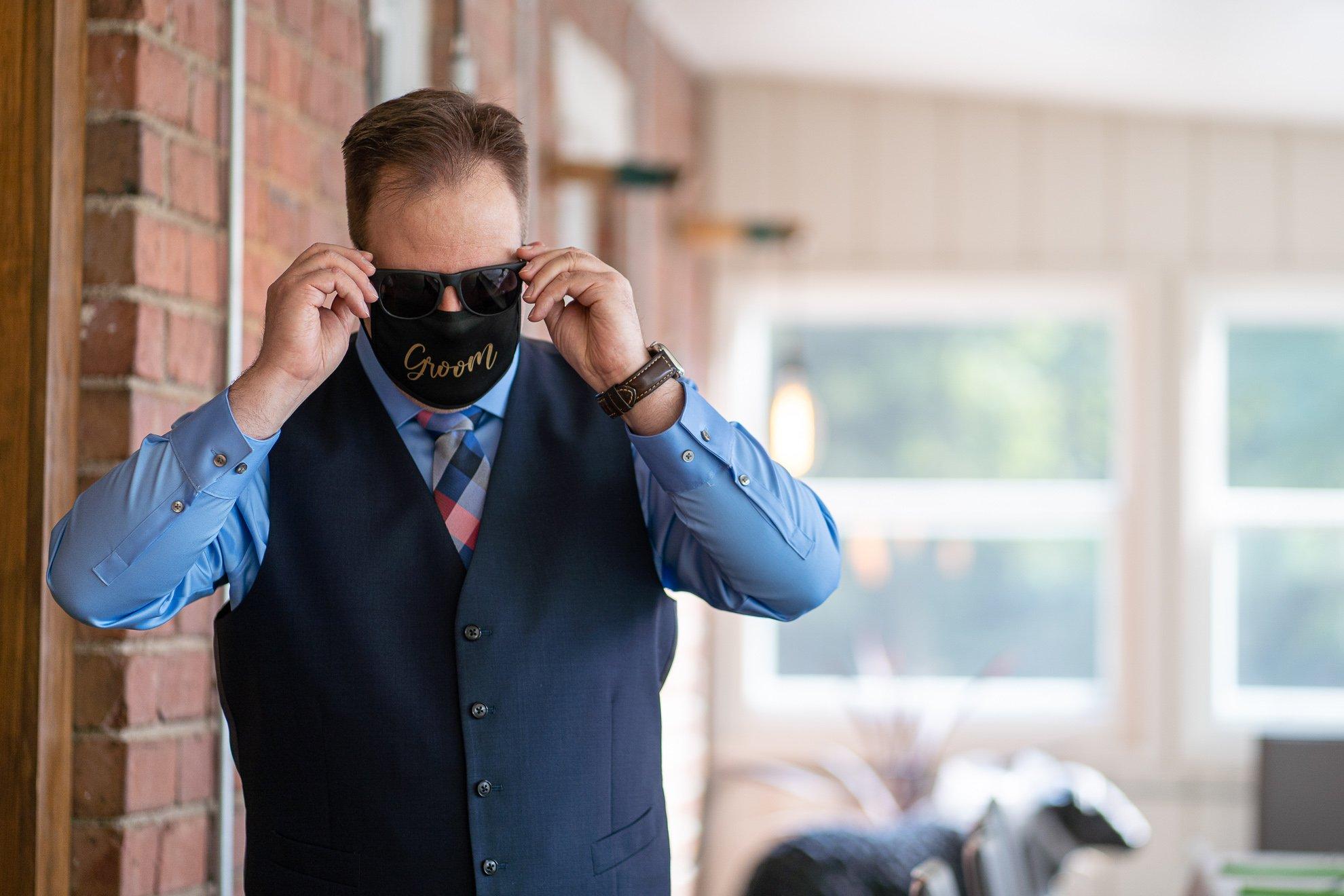 groom putting on shades