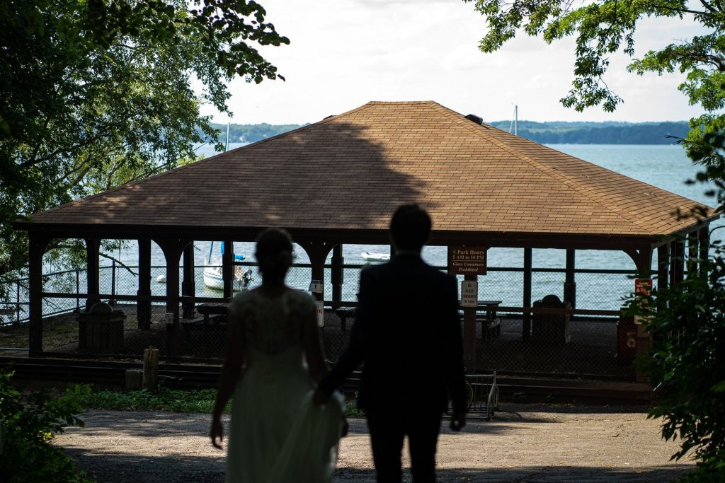 couples silhouette with lake mendota at background