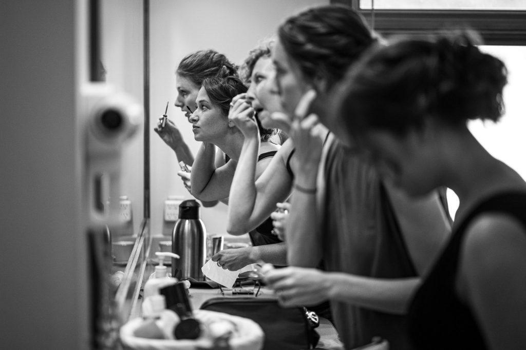 bridesmaid doing their makeup
