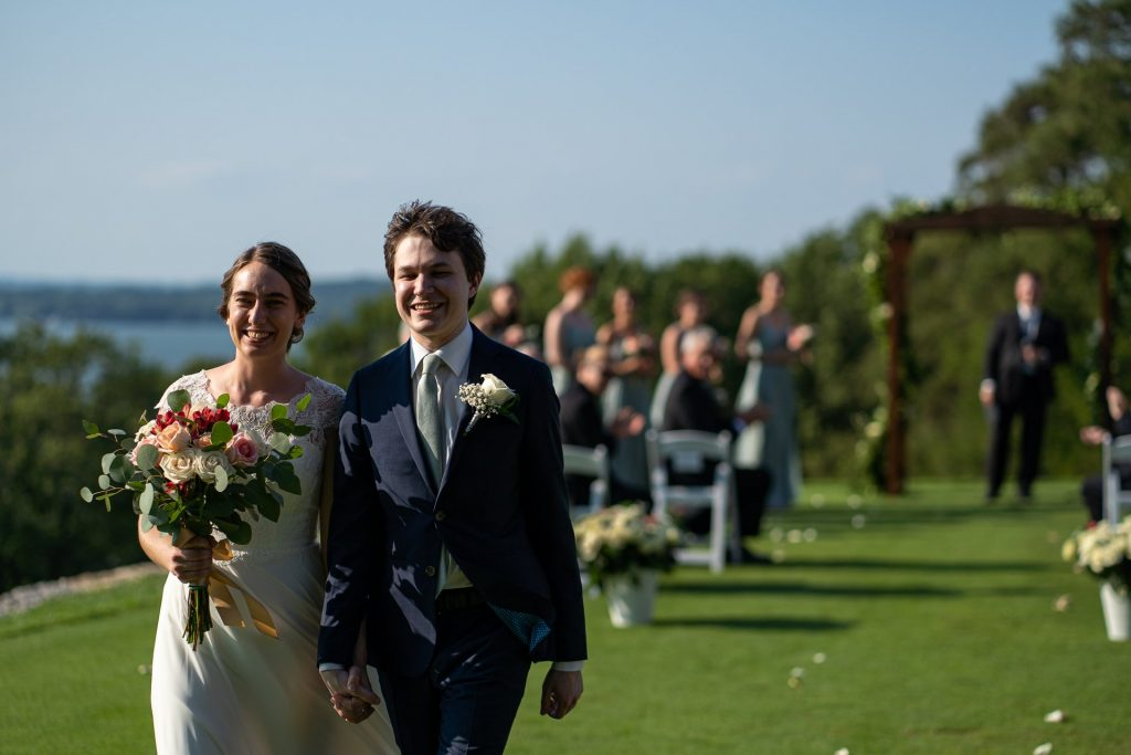 newly wed walking down the aisle in madison wi