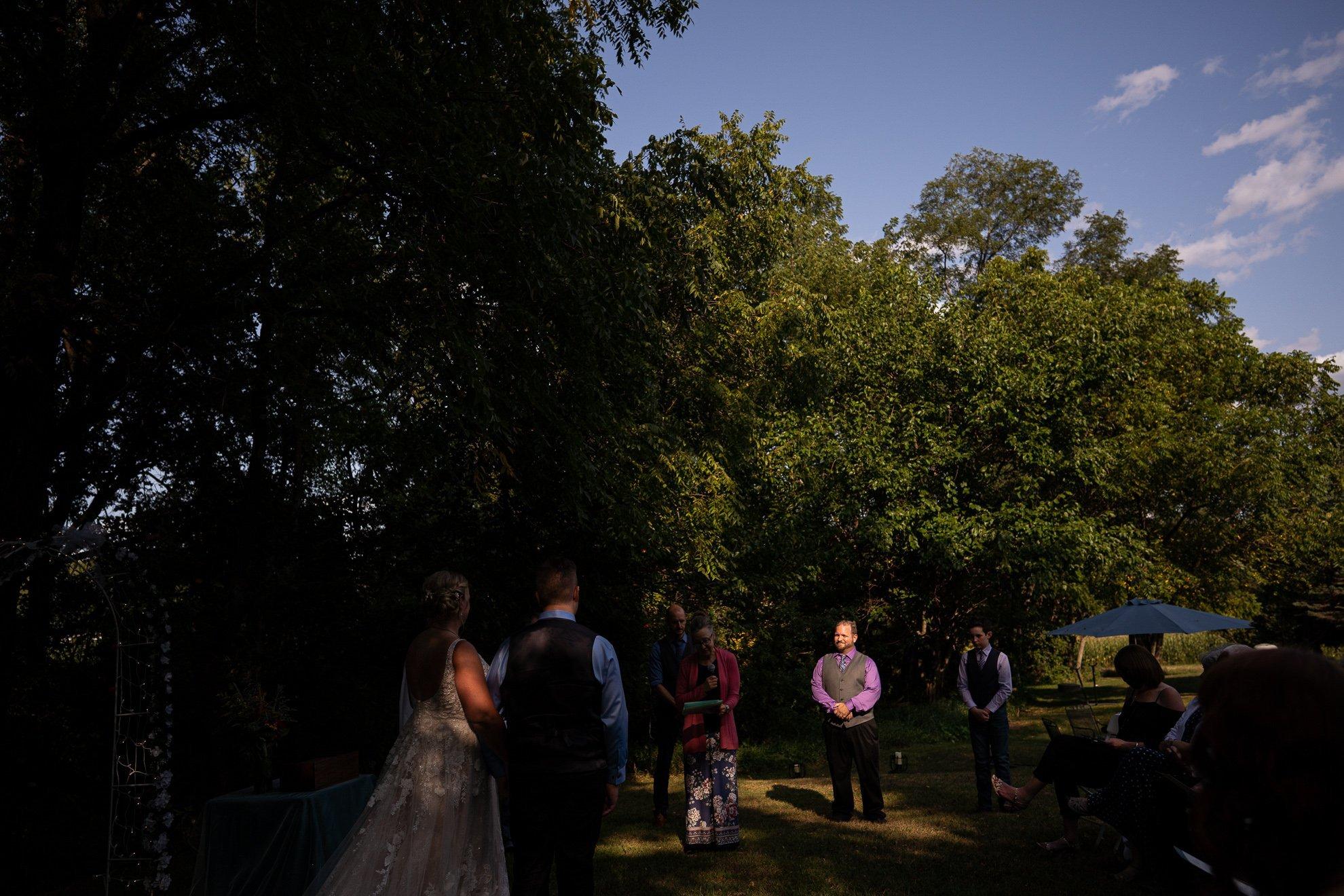 groomsman under sun ray wedding photography