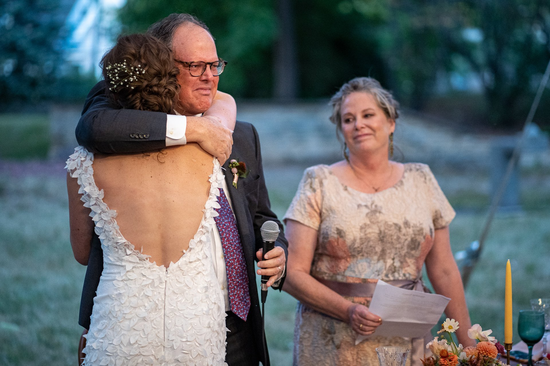 bride hugging her dad during his speech