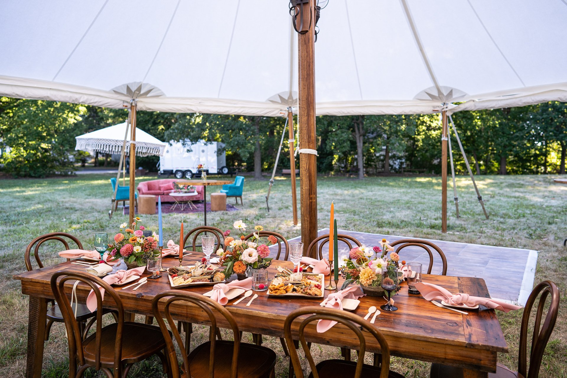 wedding reception table under a tent