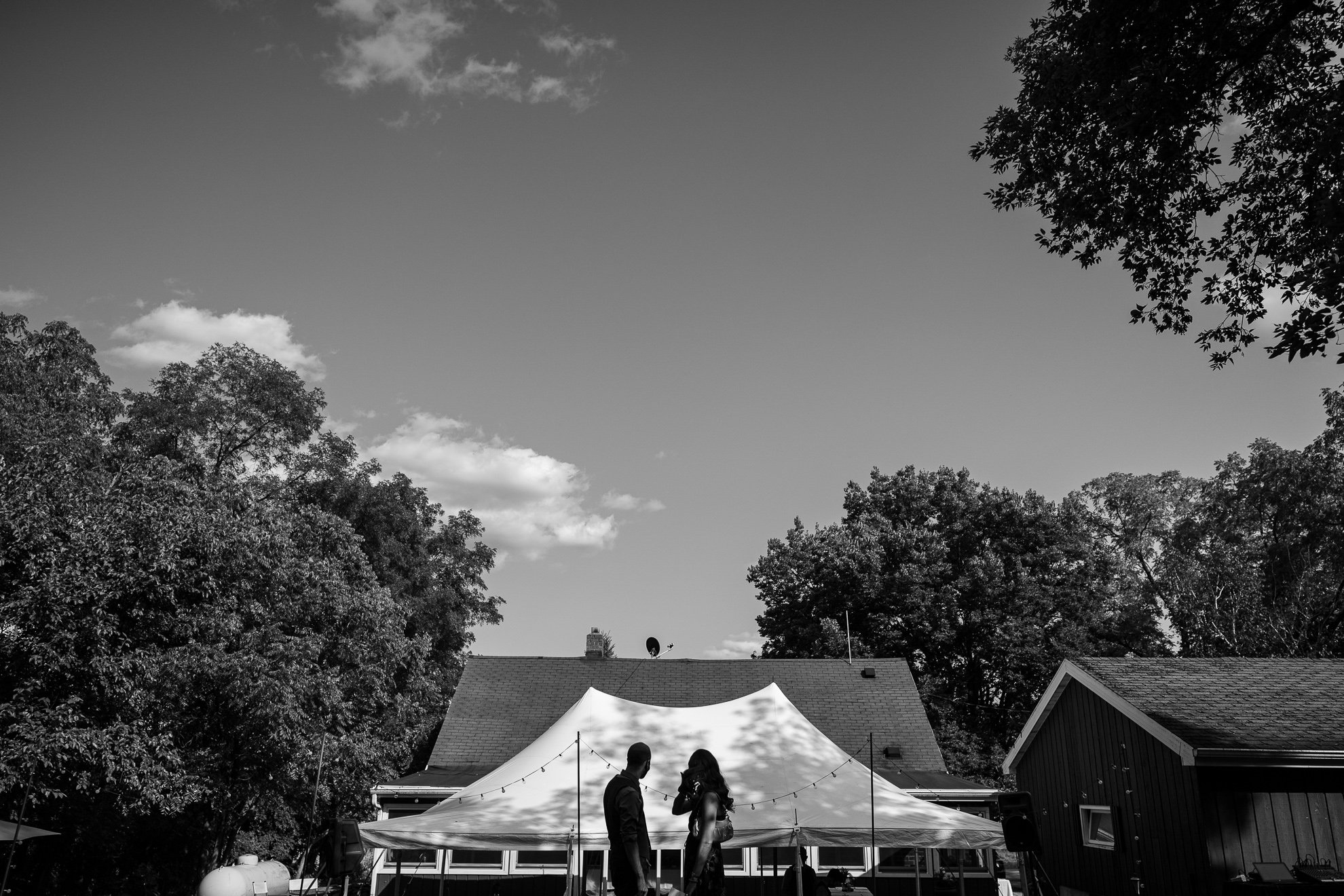 wedding tent with a couples silhouette