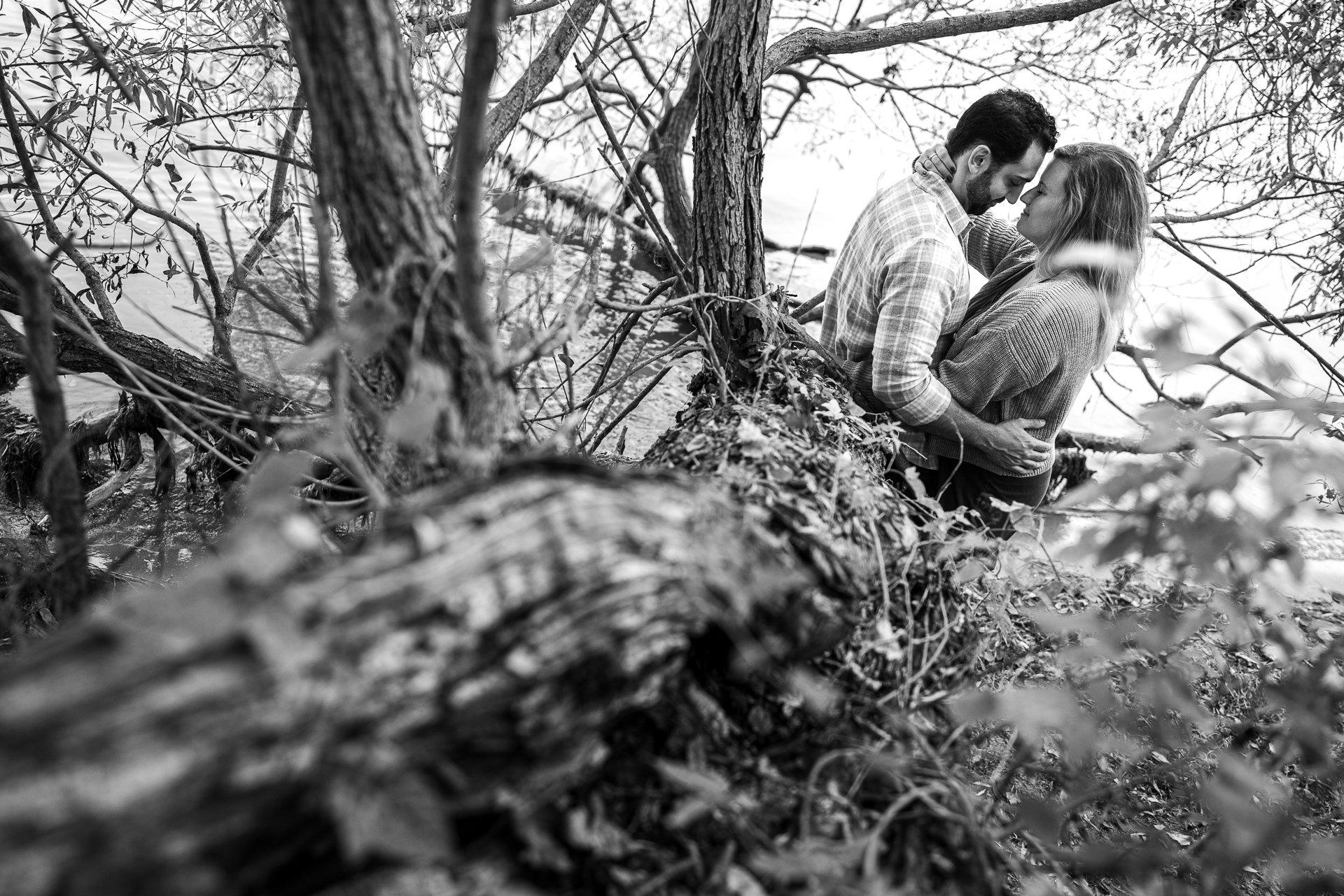 engaged couple kissing by lake mendota