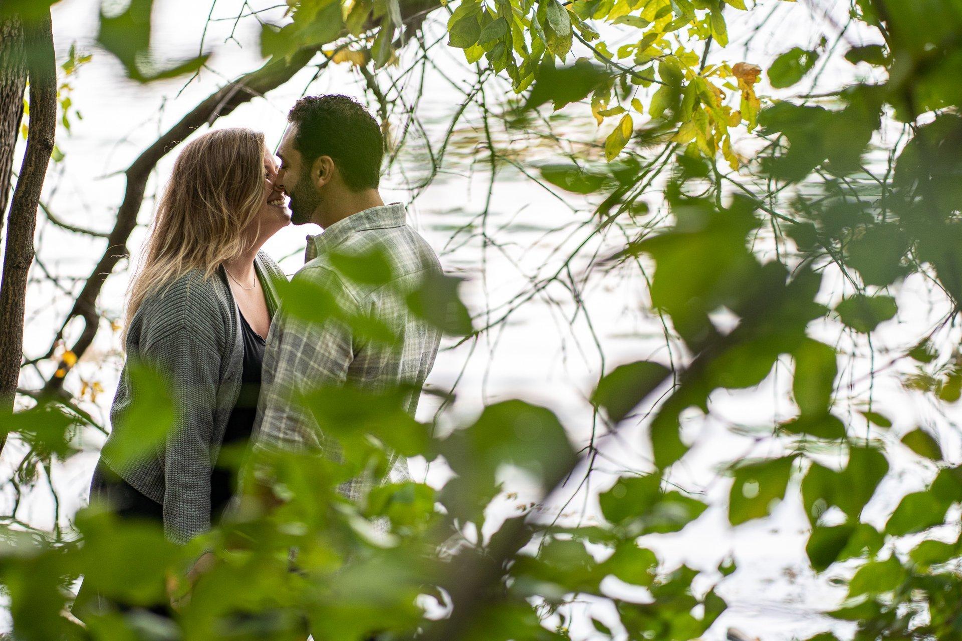 couple kissing by lake mendota