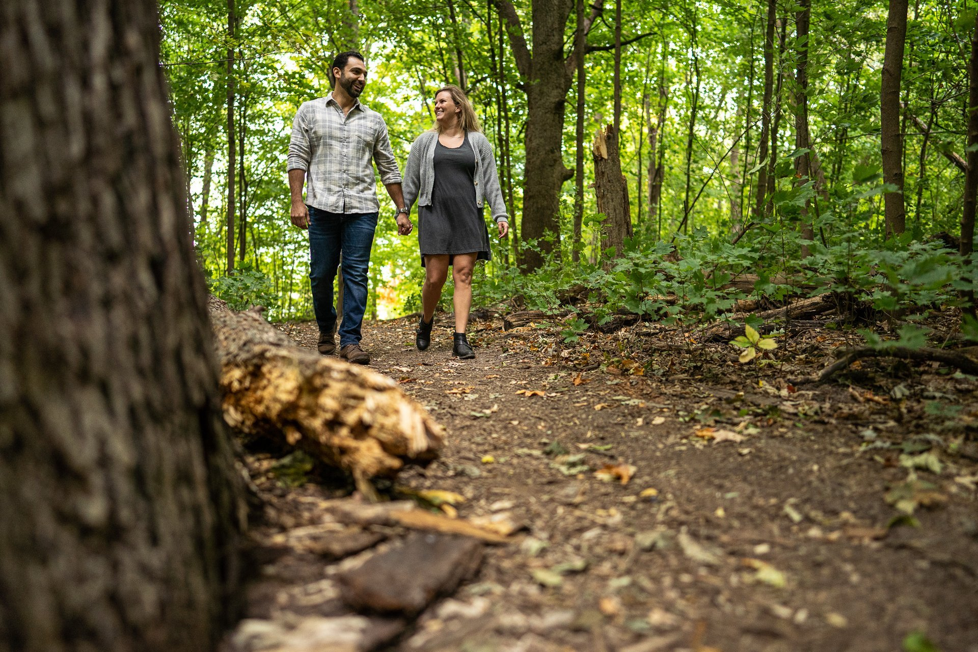 couple walking together in the woods at picnic point