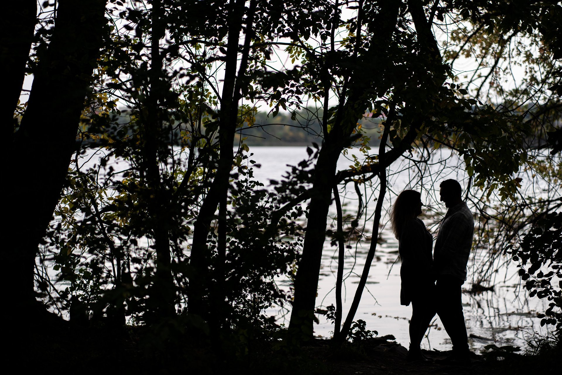 couple silhouette by lake
