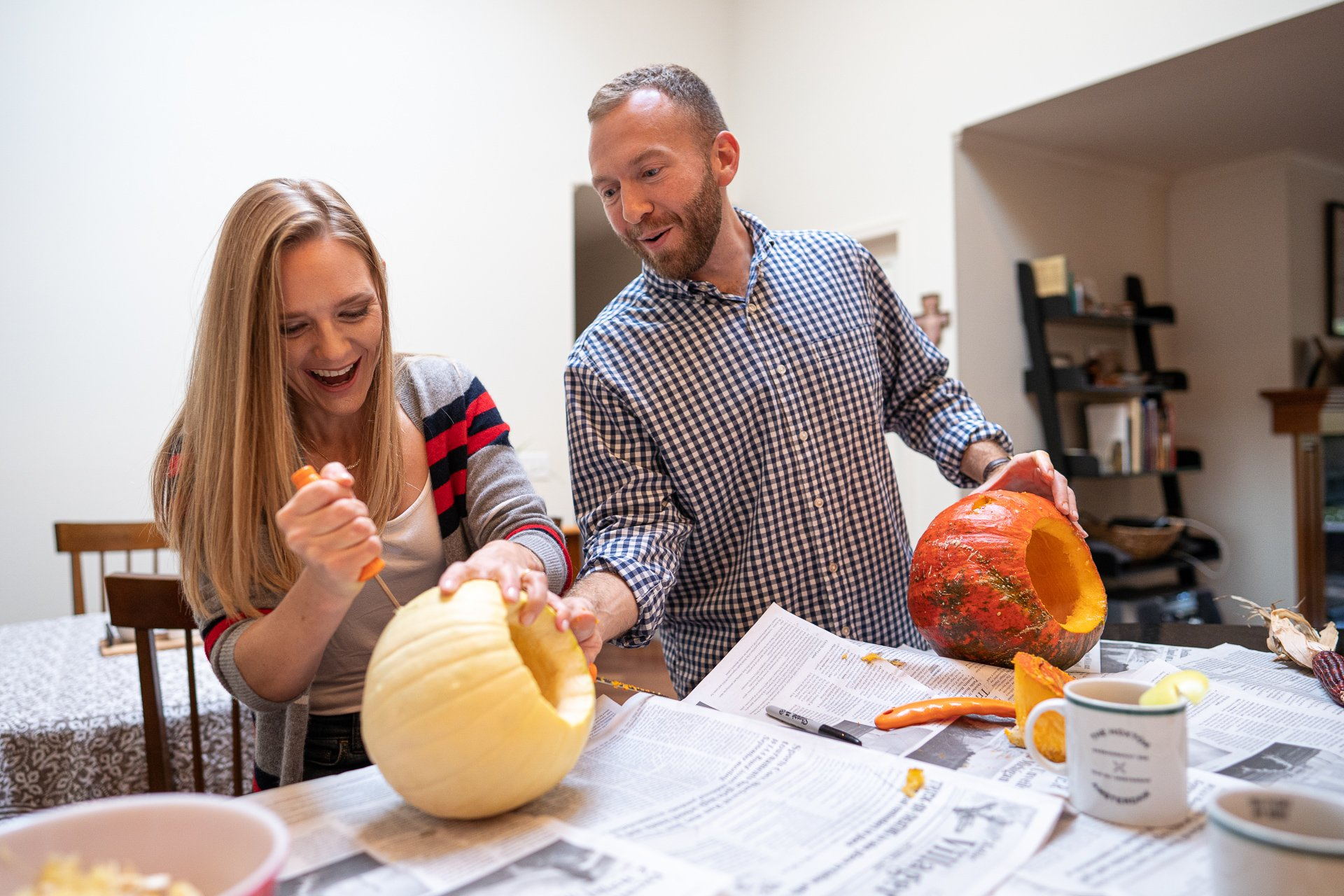 couple carving pumpkin engagement session
