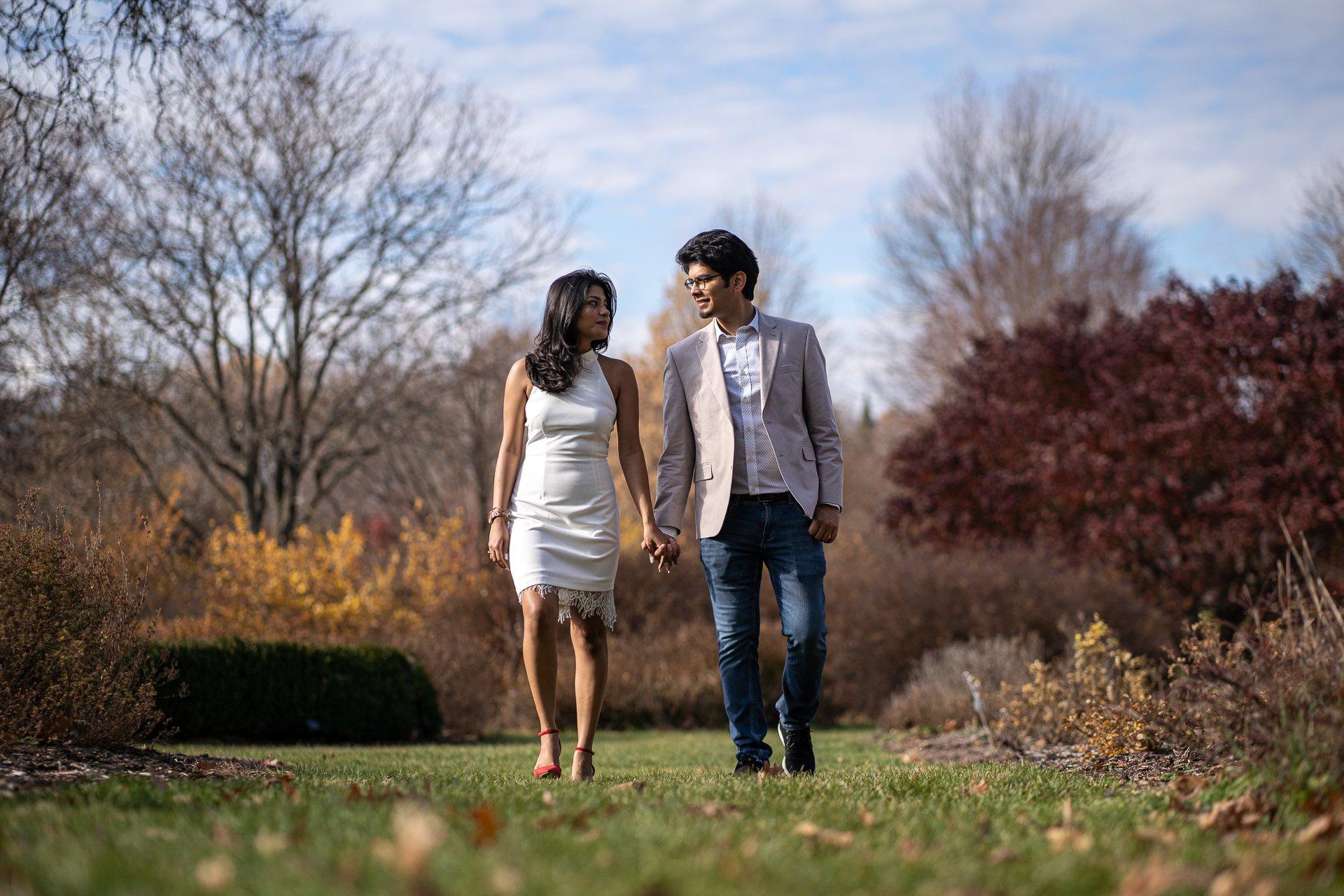 couple walking holding hands madison