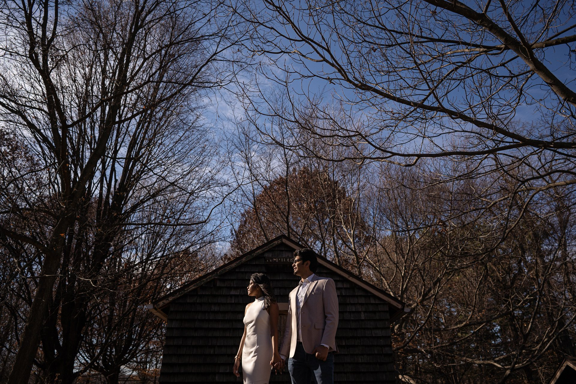 couple with shed on background engagement