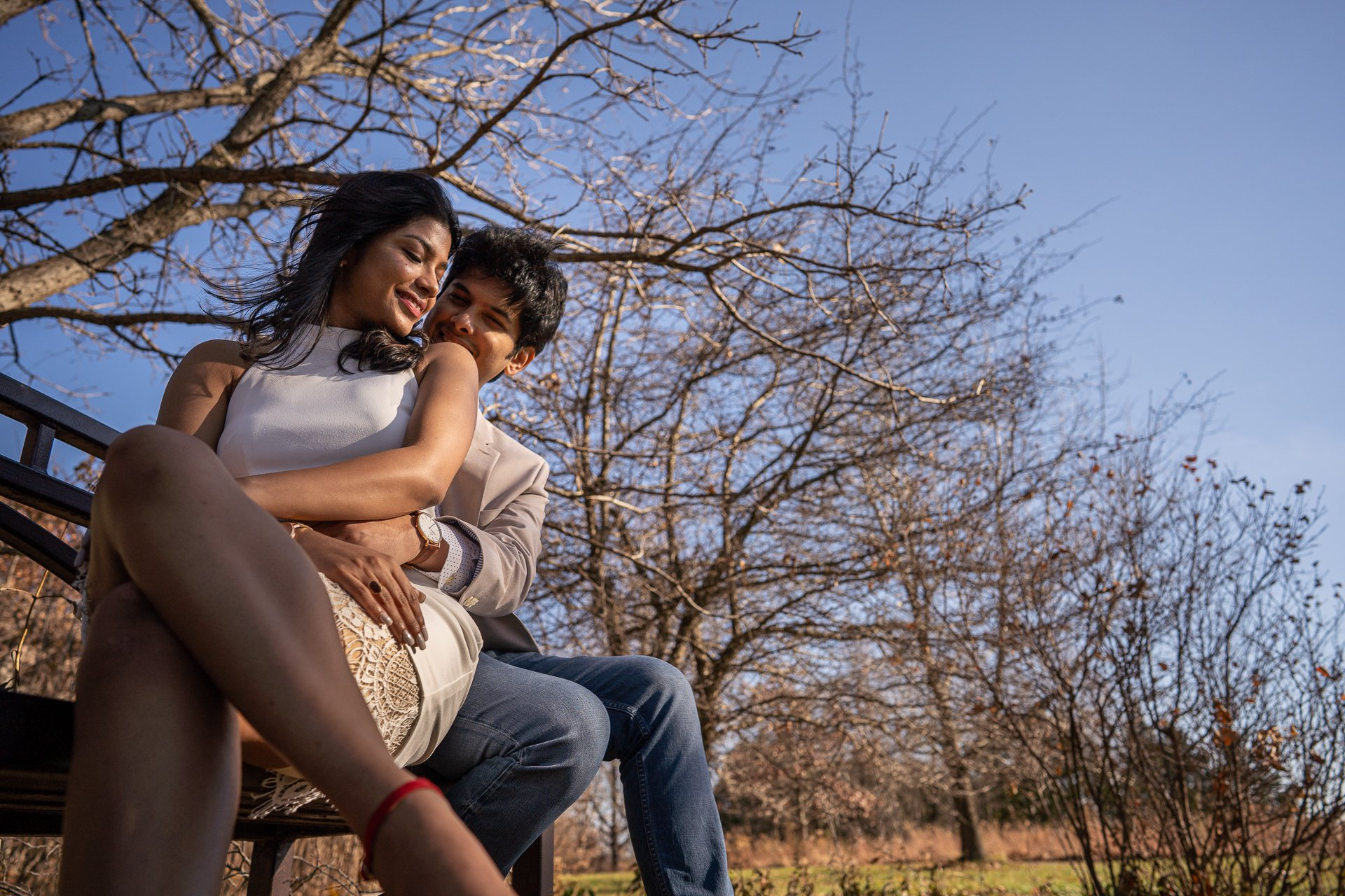 engaged couple on a bench engagement session