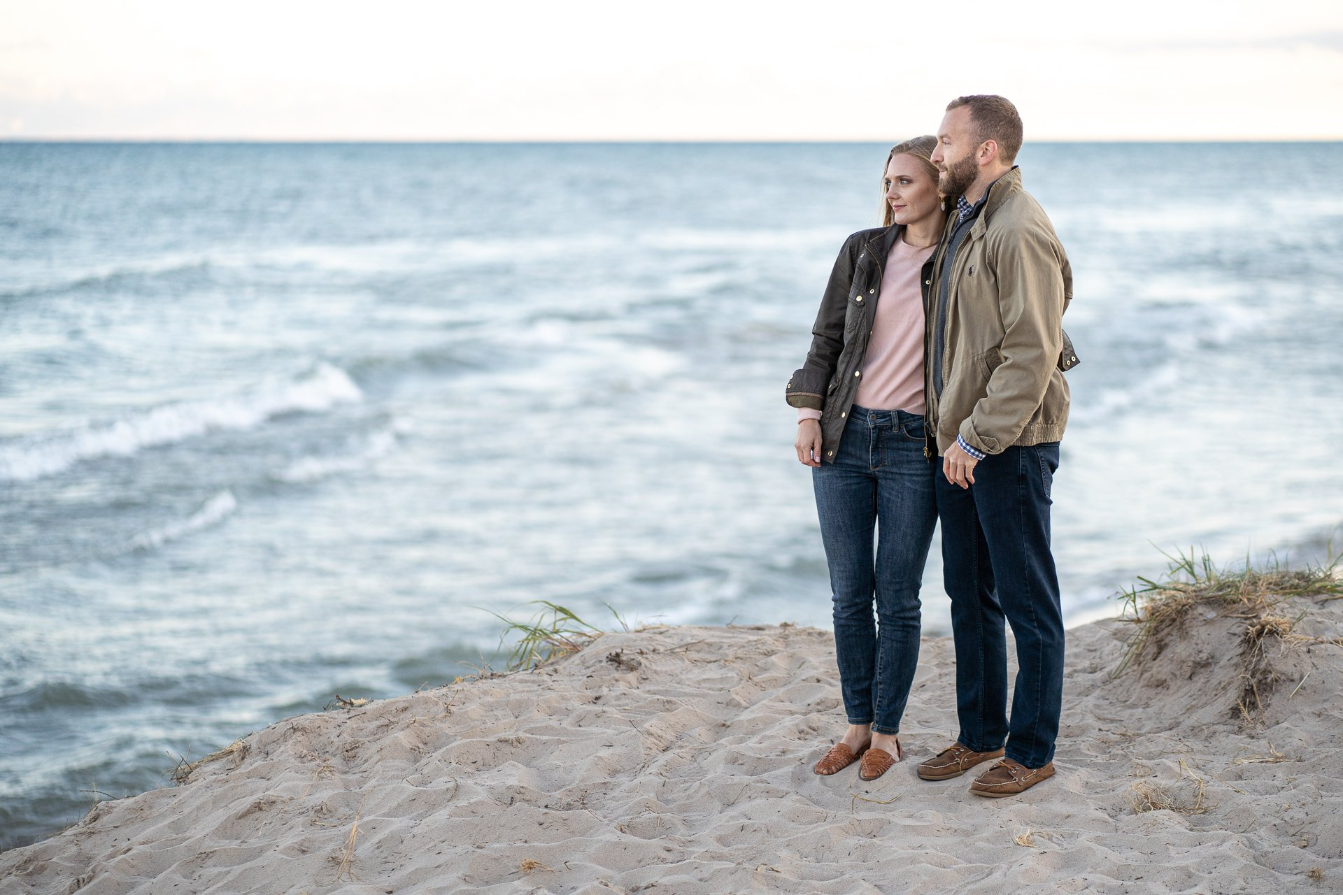 couple looking out lake michigan