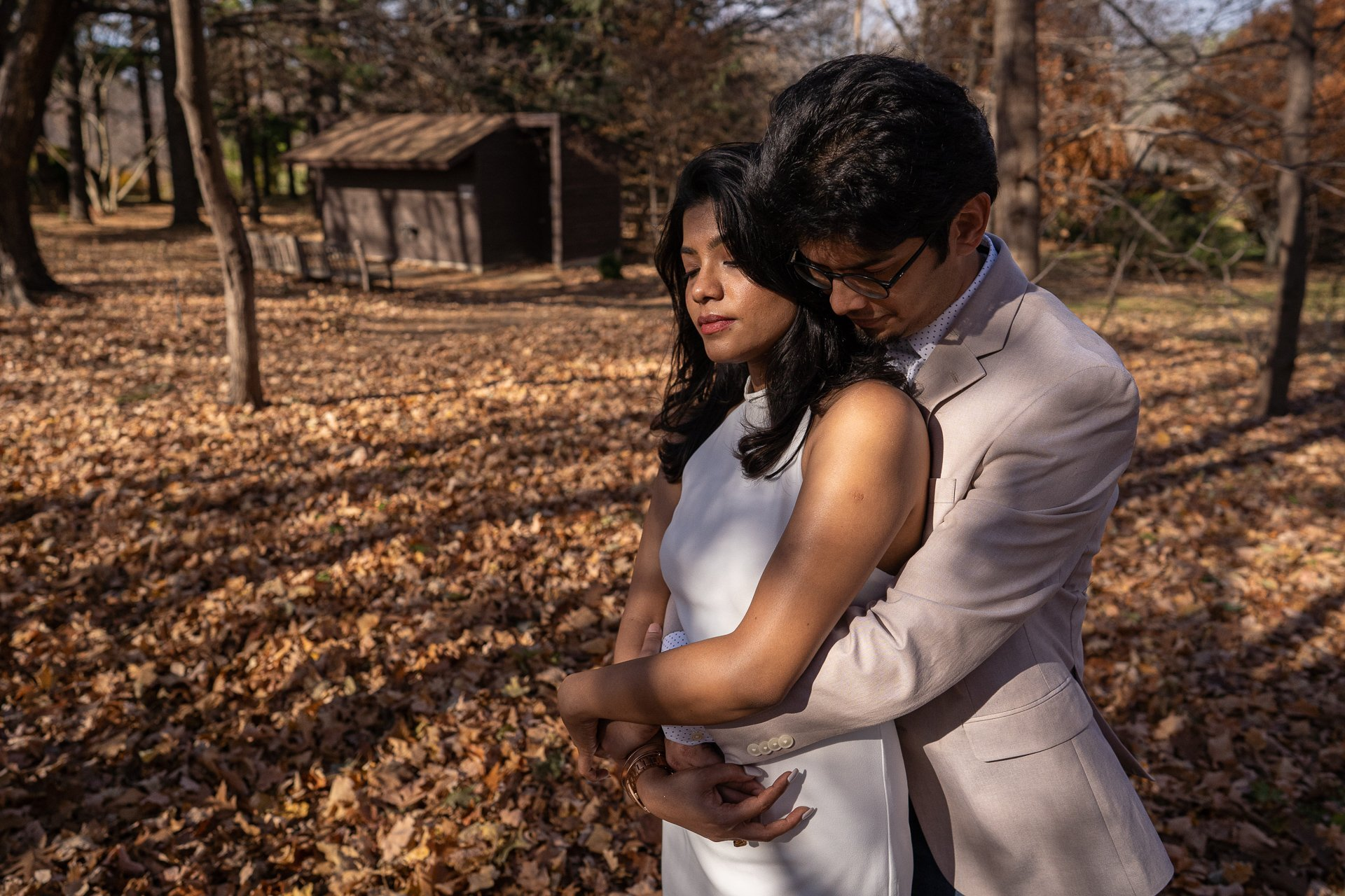 man hugging women engagement photography