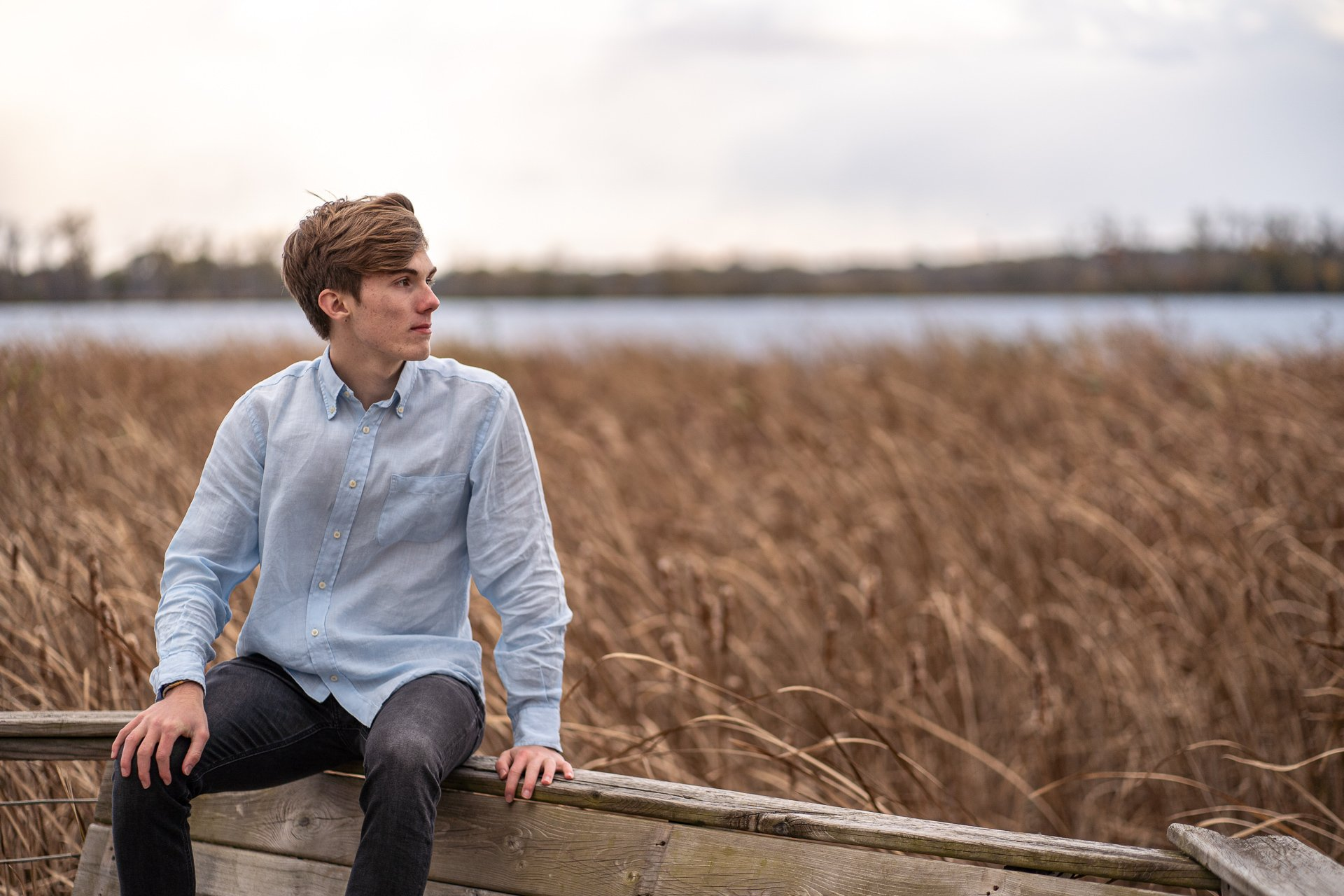 teenager looking out tall grass