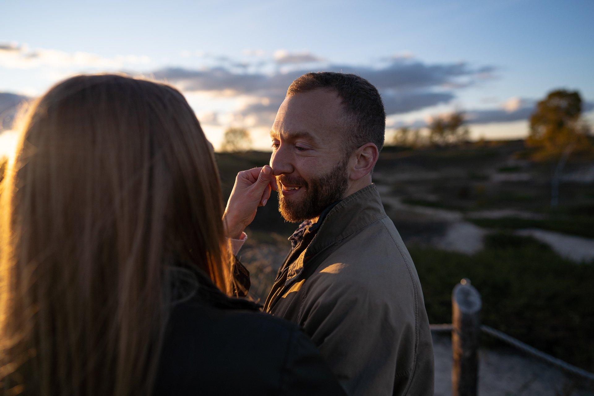 woman touching man nose