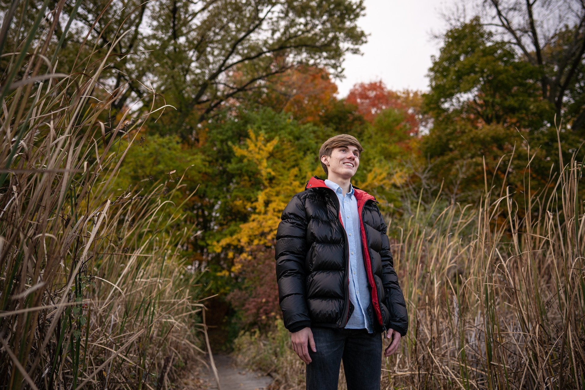 young man walking fall season