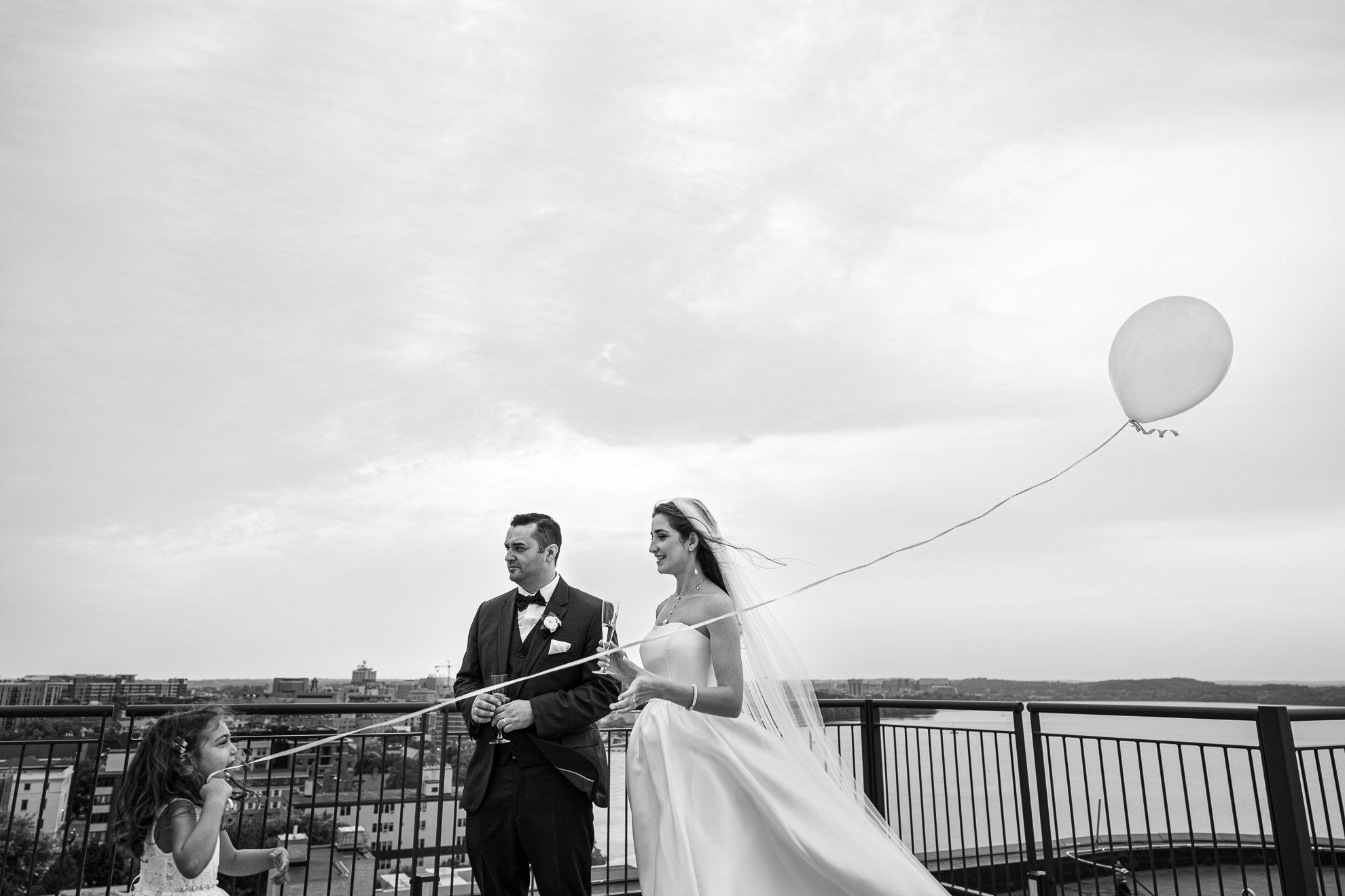 flower girl balloon bride and groom