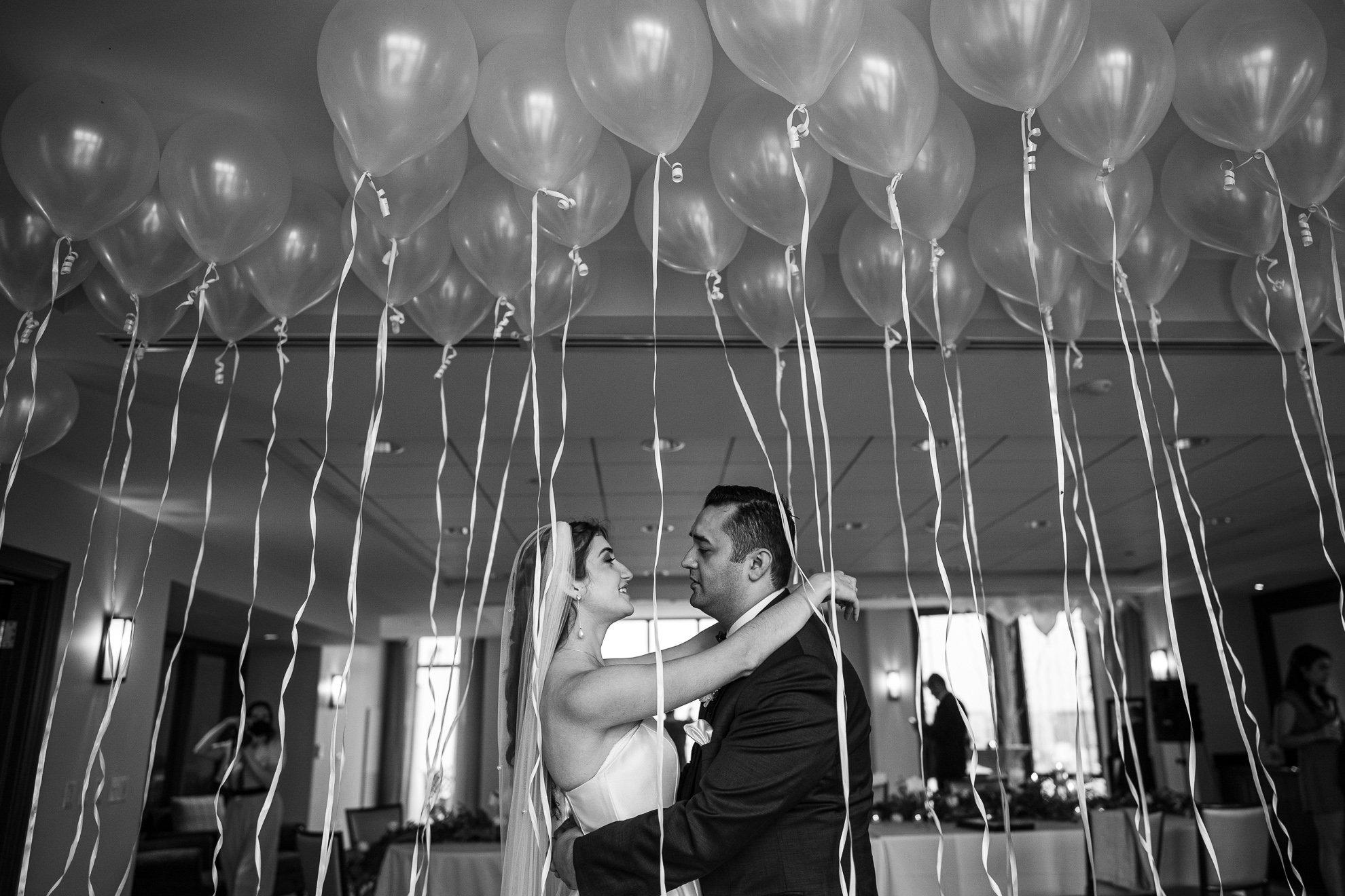 Madison WI Wedding Photographers couple dance balloons