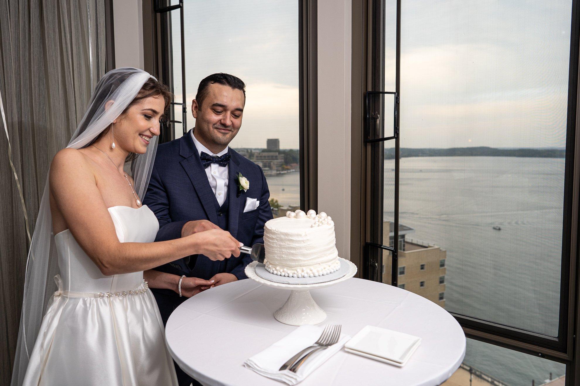 Madison WI Wedding Photographers cutting cake