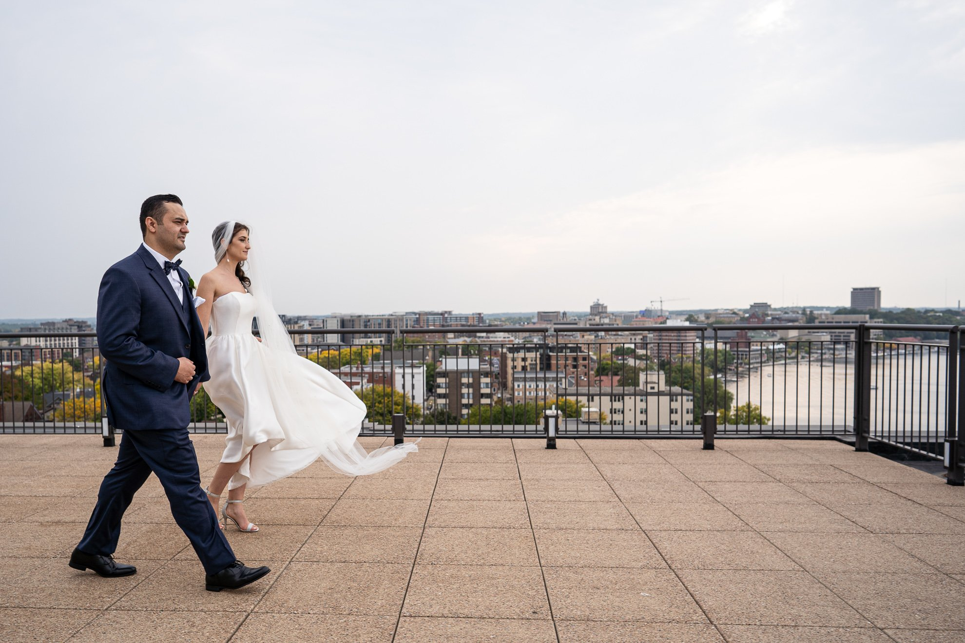Madison WI Wedding Photographers rooftop couple walk