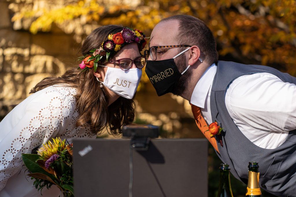 wedding photographers madison wi couple masks