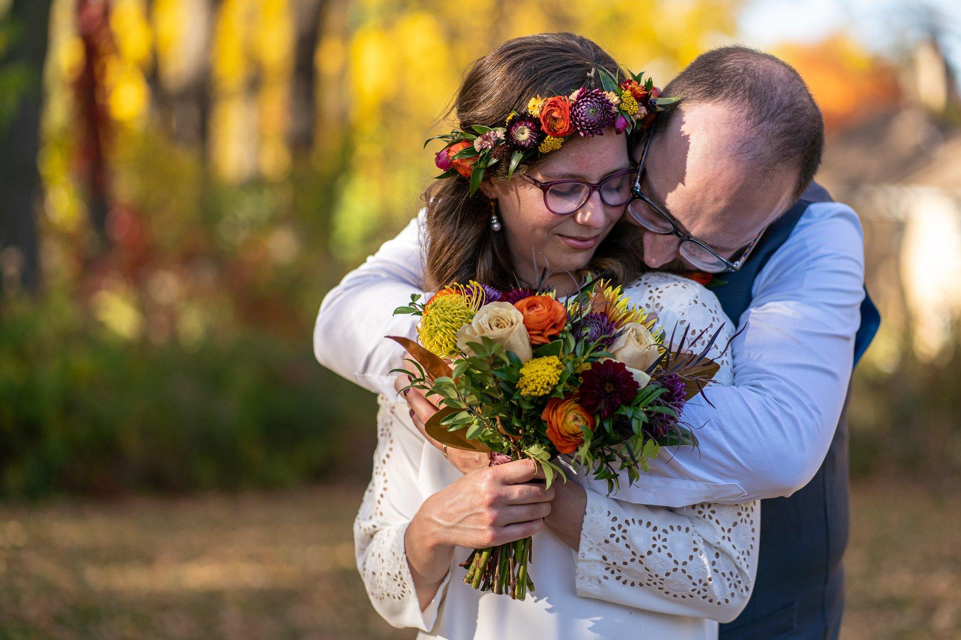 wedding photographers madison wi groom hug